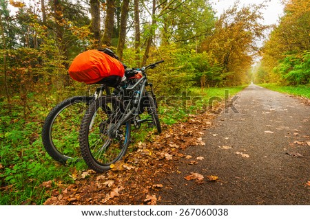 two bicycles parked in the alley - stock photo