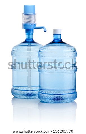 Two big bottles of water with pump isolated on a white background - stock photo