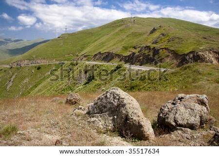 Two big stones in background mountain route - Armenia - stock photo