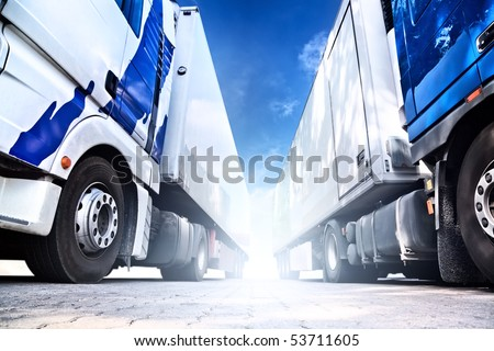 Two big trucks. Wide angle view. - stock photo