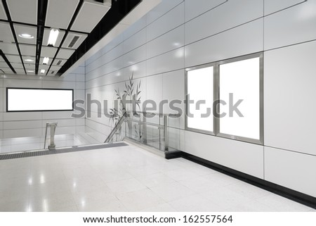 Two big vertical / portrait orientation blank billboard and one big horizontal / landscape orientation blank billboard in public transport - stock photo