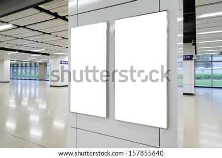 Two big vertical / portrait orientation blank billboard in public transport station - stock photo