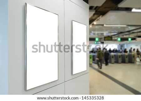 Two big vertical / portrait orientation blank billboard on white wall with passenger background - stock photo