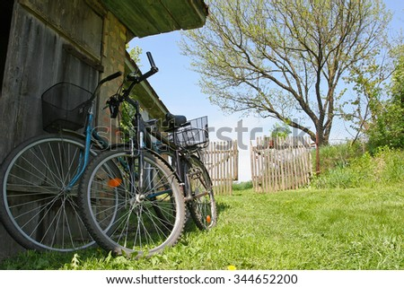 Two bikes in the spring on the farm yard