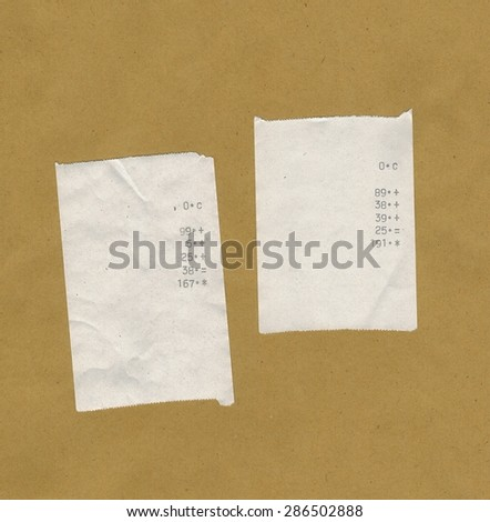 two bills or receipts isolated over light brown background - stock photo
