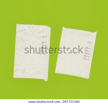 two bills or receipts isolated over light green background - stock photo
