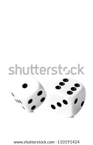 Two black and white dices in motion against a white background - stock photo