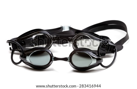 Two black goggles for swimming. Isolated on white background - stock photo