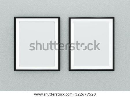 Two black picture frames over light grey wall - stock photo