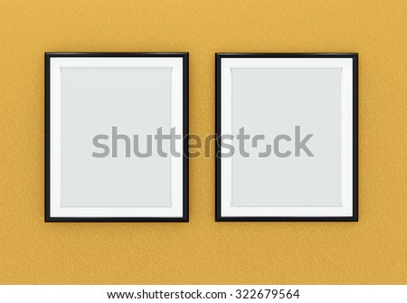 Two black picture frames over orange wall - stock photo