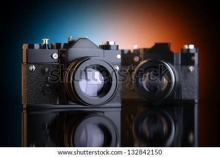 Two Black Vintage Film Photo-Cameras - stock photo
