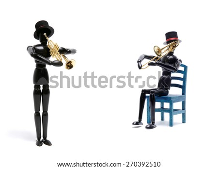 Two  black wooden Artist's Figure as musicians isolated on white.Studio shot