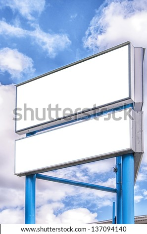Two blank billboards against a blue sky background for your advertising usage. - stock photo