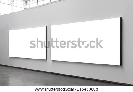 Two blank billboards situated at a generic city location that could be anywhere in the world. - stock photo