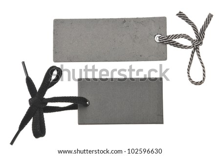 two blank black cardboard paper labels or tag isolated on the white background - stock photo