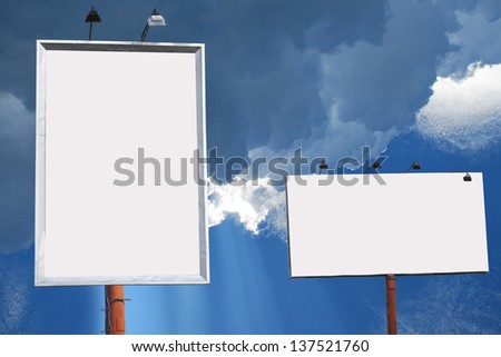 two blank boards lined with blue sky background