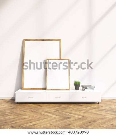 Two blank frames on white floor shelf, white wall. Concept of painting. Mock up. 3D rendering