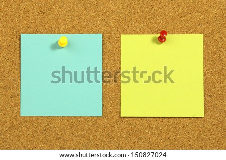 two blank note card on cork board