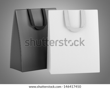 two blank shopping bags isolated on gray background - stock photo