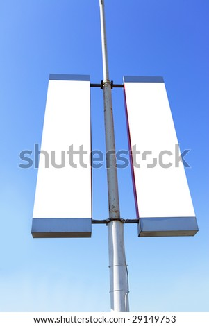 Two blank signs on the post, put your own text or image here - stock photo