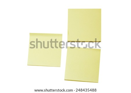 Two blank yellow sticky notes and a stack, isolated on white background. - stock photo