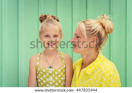 Two blondes Mom and daughter smiling - stock photo