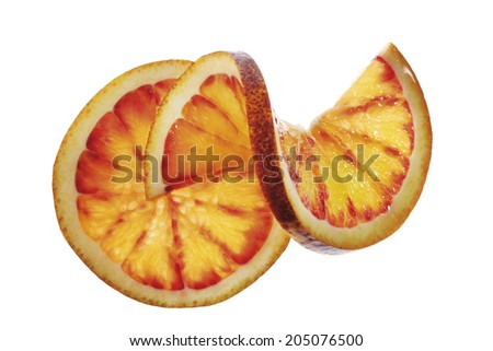 Two blood orange slices, one chased, close-up - stock photo