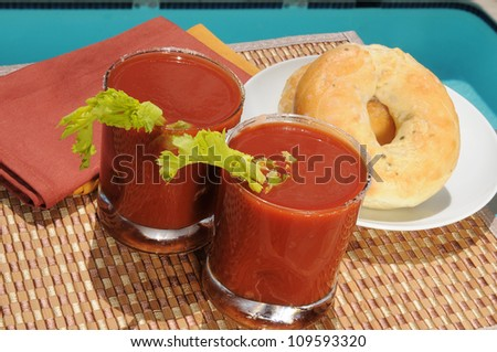 Two Bloody Mary drinks and bagels served by the pool