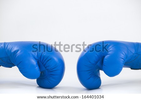 Two Blue Boxing Gloves next to each other showing sports and power/Two Blue Boxing Gloves - stock photo