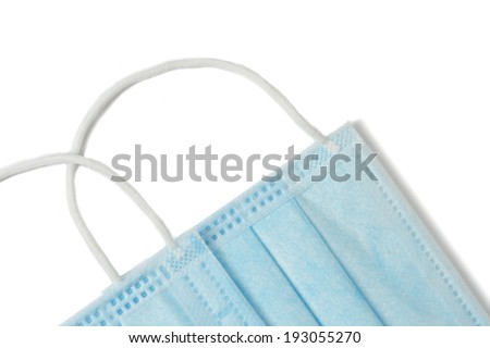 Two blue medical masks on a white background - stock photo