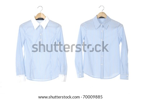 Two blue shirt on a hanger - stock photo
