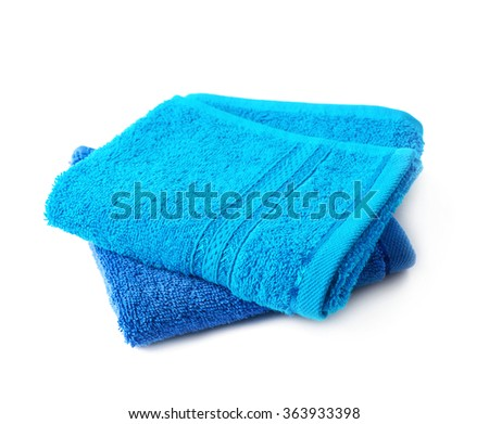 Two blue terry cloth towels isolated - stock photo