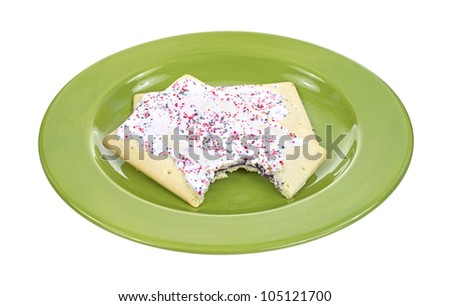 Two blueberry toaster pastries with one bitten on a green plate. - stock photo