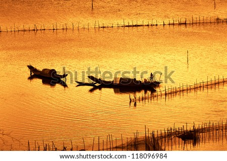 Two boat are fishing on the river in sunset, in Hue, Vietnam - stock photo