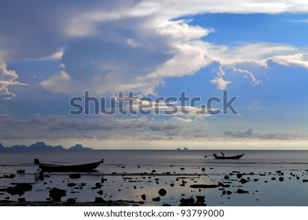 Two boat silhouettes at sunset on Koh Samui island, Thailand - stock photo