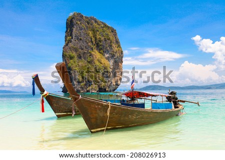 Two boat stay on the white sand beach islands