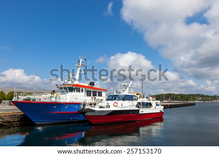 Two boats moored at the quay at the port of Stavanger, Norway - stock photo