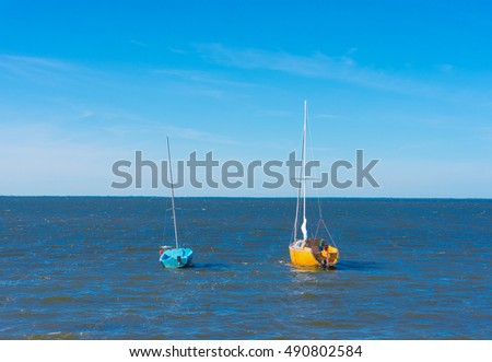 Two boats on sea water
