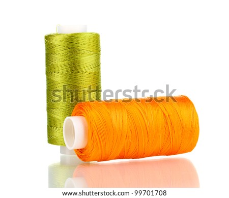 Two bobbin thread isolated on white - stock photo