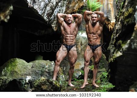Two bodybuilders posing - stock photo
