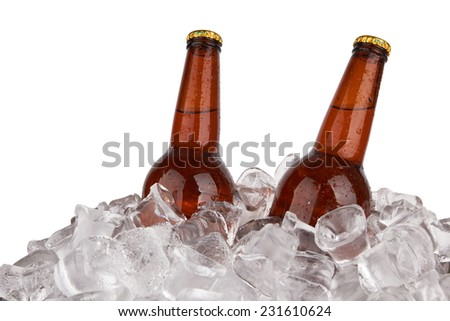 Two bottles of beer on ice isolated on white background