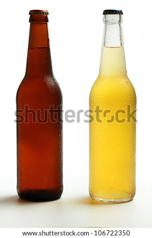 Two bottles of chilled beer on a white background.