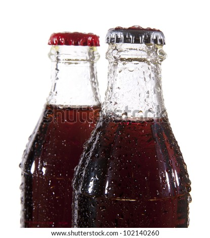 two bottles of cold cola with water drops. Isolated on white background - stock photo