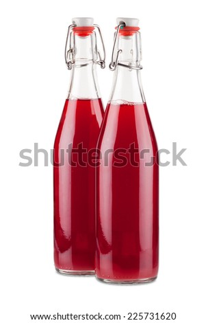 Two bottles of fresh currant syrup isolated on white background