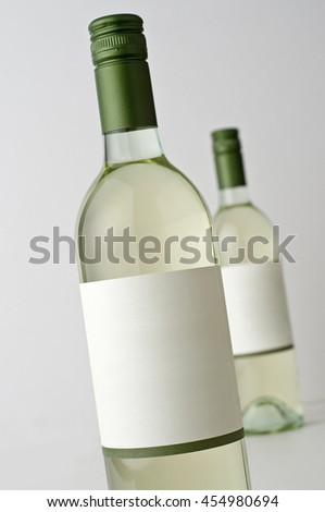 Two bottles of Sauvignon Blanc wine, blank label, ad your own text - stock photo