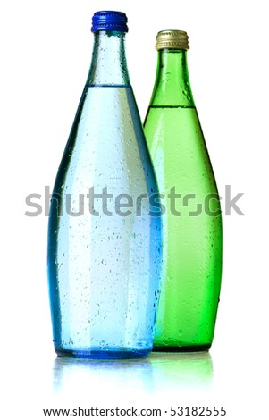 Two bottles of soda water with water drops. Isolated on white background - stock photo
