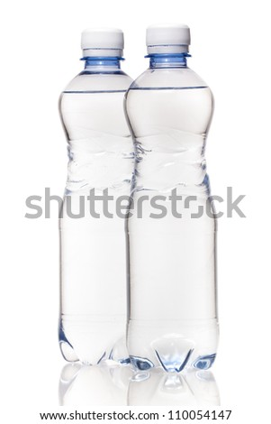 Two bottles of water on white background