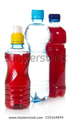 Two bottles with compote and a bottle with the cleared drinking water, isolated on white