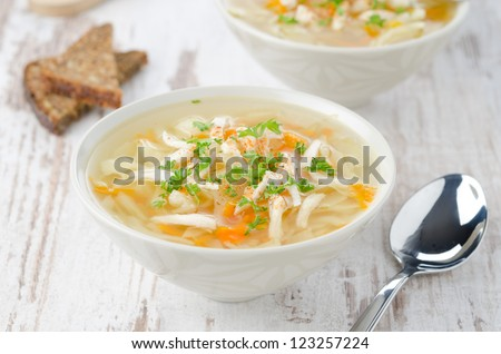 two bowls vegetable soup with chicken and parsley horizontal - stock photo