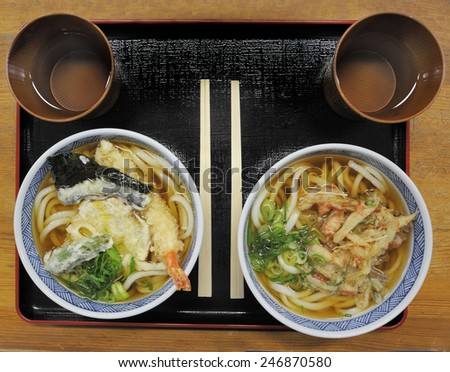 Two bowls with Japanese noodle soup at a restaurant - stock photo